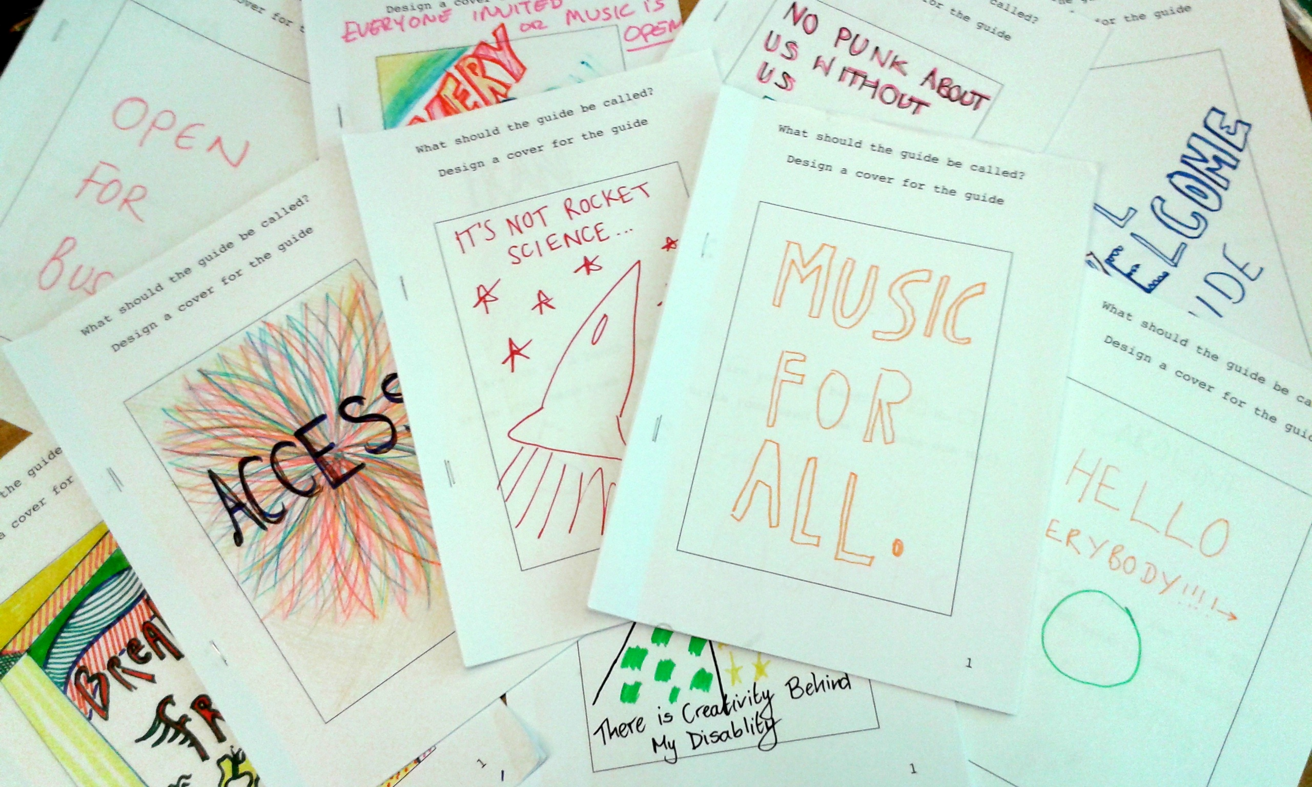 A selection of the guide covers created by workshop participants, with titles such as 'Access', 'It's not rocket science...', 'Music For All', and 'No punk about us without us'.